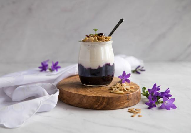 Granola yogurt parfait with blueberry compote